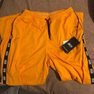 Men's yellow track pants